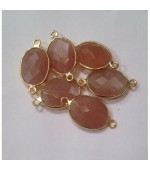 Gold plated oval moonstone fasct