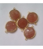 Gold plated round pink moonstone fasct